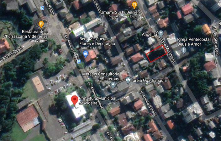 Lote com área de 351,00 m², sendo 13,00 m de frente, localizado na Rua Afonso Marchioro, próximo à Prefeitura Municipal.